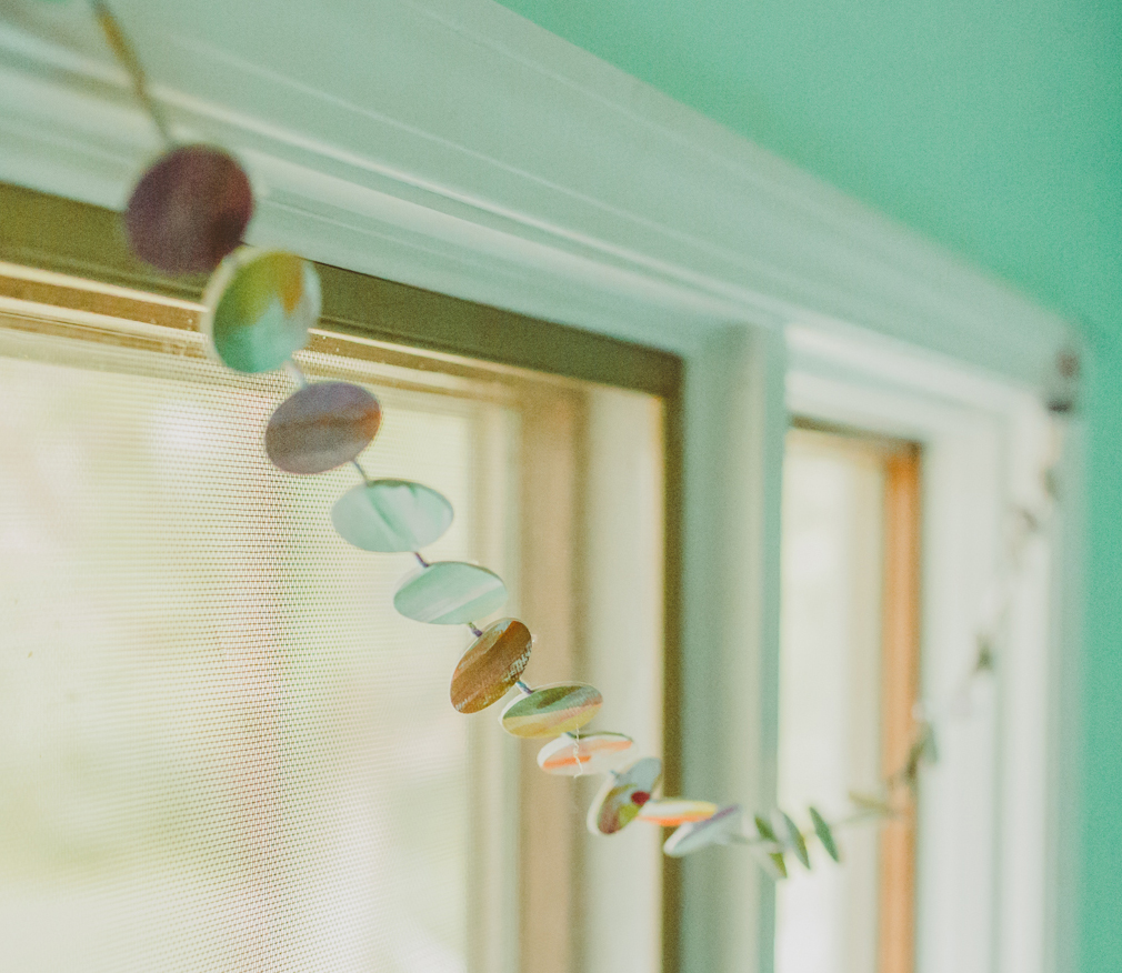 Paper Punch Garland craft DIY with Kids for the Mama Village